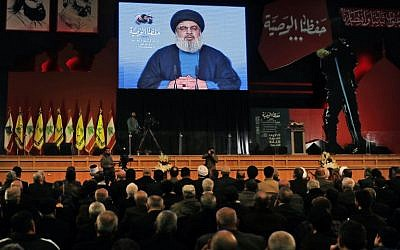 Hezbollah leader Hassan Nasrallah delivers a televised speech during a ceremony in Beirut to commemorate Hezbollah leaders who have been killed, February 16, 2018. (AFP Photo/Joseph Eid)