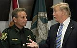 US President Donald Trump (R) speaks with Broward County Sheriff Scott Israel (L) while visiting first responders at Broward County Sheriff's Office in Pompano Beach, Florida, on February 16, 2018, three days after a mass shooting that claimed 17 lives at a nearby high school. ( AFP PHOTO / JIM WATSON)
