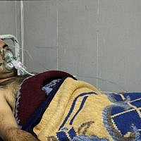 A picture taken on February 16, 2018, shows a Syrian man receiving treatment at a hospital in the town of Afrin. Six men were treated for breathing difficulties in the main hospital in Afrin after shelling by a Turkish-led offensive on their village, the general director of the Afrin hospital said. (AFP PHOTO / Ahmad Shafie BILAL)
