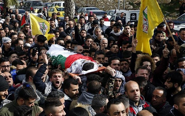 Relatives mourn over the body of Hamzeh Yousef Zamaareh, during his funeral in the West Bank city of Halhul, on February 17, 2018. (AFP Photo/Hazem Bader)