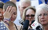 Marjory Stoneman Douglas High School student Emma Gonzalez (L) reacts during her speech at a gun control rally at the Broward County Federal Courthouse in Fort Lauderdale, Florida, on February 17, 2018. (AFP Photo/Rhona Wise)