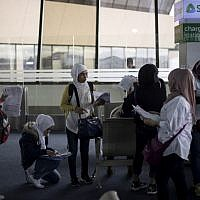 Filipina workers returning home from Kuwait arrive at Manila International Airport on February 18, 2018. (AFP/ NOEL CELIS)