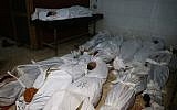 The bodies of civilians who were killed in Syrian army bombardment on the town of Hamouria in the rebel-held enclave of Eastern Ghouta are seen lying on the ground at a make-shift morgue the morning after the attacks on February 20, 2018. (AFP PHOTO / ABDULMONAM EASSA)