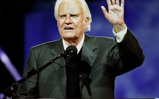 In this file photo taken on June 24, 2005 Evangelist Billy Graham delivers his message at the Billy Graham Crusade at Flushing Meadows Park in Flushing Meadows, New York. (AFP PHOTO / Timothy A. CLARY)