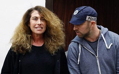 Stella Handler (L), CEO of the Bezeq telecom company, appears in the Tel Aviv District Court on February 21, 2018. (AFP Photo/Jack Guez)