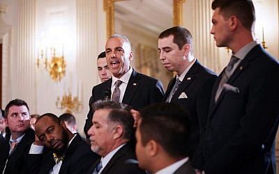 Andrew Pollack (C), flanked by his sons, speaks during 'listening session' on gun violence with US President Donald Trump, teachers and students in the State Dining Room of the White House on February 21, 2018. (AFP Photo/Mandel Ngan)