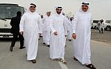 Qatari Minister of Municipality and Environment Mohammad Bin Abdullah Mitaab Al-Rumaihi, right, Secretary-General of the Qatar 2022 Supreme Committee Hassan al-Thawadi, center, and Saad bin Ahmad Al Muhannadi President of the Public Works Authority 'Ashghal attend the inauguration of the Supreme Committee for Delivery & Legacy's Tree Nursery in Doha, on February 22, 2018. (AFP/KARIM JAAFAR)