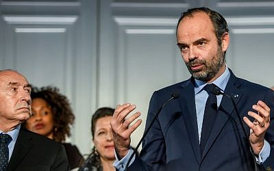 French Prime Minister Edouard Philippe, flanked by members of the government, gestures as he delivers a speech during the presentation of the national plan for the prevention of radicalization, in Lille, northern France, on February 23, 2018. (AFP/Philippe Huguen)