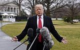 US President Donald Trump fields questions from the media as he departs from the South Lawn of the White House on February 23, 2018. (AFP Photo/Olivier Douliery)