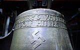"""A picture taken on May 19, 2017, shows a Nazi-era church bell that bears a swastika and the words """"All for the Fatherland -- Adolf Hitler"""" (""""Alles fuer's Vaterland - Adolf Hitler"""") hanging in the steeple of the St. Jakob church in Herxheim am Berg, Germany. (AFP Photo/dpa/Uwe Anspach)"""