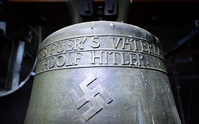 "A picture taken on May 19, 2017, shows a Nazi-era church bell that bears a swastika and the words ""All for the Fatherland -- Adolf Hitler"" (""Alles fuer's Vaterland - Adolf Hitler"") hanging in the steeple of the St. Jakob church in Herxheim am Berg, Germany. (AFP Photo/dpa/Uwe Anspach)"