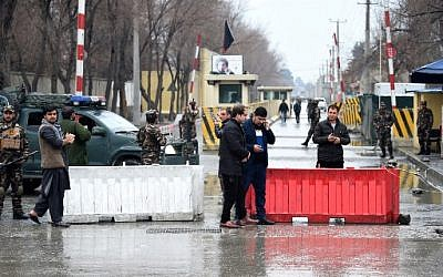 Afghan security personnel stand guard near the site of a suicide bombing at Shash Darak in Kabul on February 24, 2018 .(AFP PHOTO / WAKIL KOHSAR)