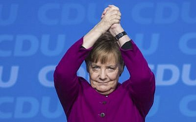 German Chancellor and leader of the Christian Democratic Union (CDU) Angela Merkel cheers after delivering her speech during the party's congress on February 26, 2018 in Berlin. (AFP PHOTO / Stefanie LOOS)