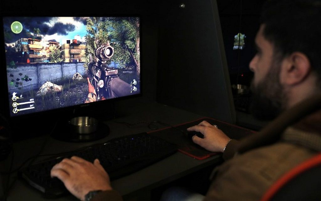 "A Lebanese man plays a computer game created by the Hezbollah terror group called ""Sacred Defense"" in a southern suburb of Beirut on February 27, 2018. (AFP Photo/Joseph Eid)"