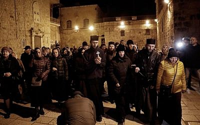 Christian worshippers prepare to enter the Church of the Holy Sepulchre in Jerusalem after it reopened on February 28, 2018, following a three-day closure to protest against Israeli tax measures and a proposed law. (AFP/THOMAS COEX)