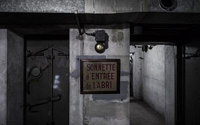This picture taken on January 23, 2018 shows a sign that reads, 'ring to enter the bunker'  in a World War II bunker located under the Gare de l'Est (the East railway station) in the French capital Paris. (AFP PHOTO / Philippe LOPEZ)