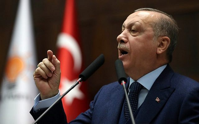 President of Turkey and leader of the Justice and Development Party (AK Party) Recep Tayyip Erdogan delivers a speech during the party's group meeting at the Grand National Assembly of Turkey (TBMM), in Ankara, on January 30, 2018. (DEM ALTAN/AFP)