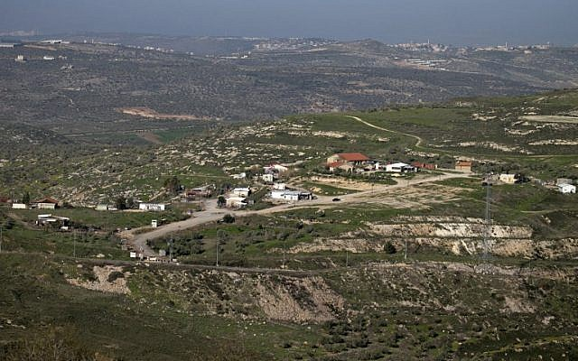 Illustrative: A picture taken from the outskirts of the West Bank city of Nablus shows a view of the illegal outpost of Havat Gilad on February 2, 2018. (AFP Photo/Jaafar Ashtiyeh)