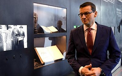 Poland's Prime Minister Mateusz Morawiecki visits the Ulma Family Museum that documents the fate of the Polish Ulma family, killed in March 1944 by Nazi Germans for rescuing Jews during the Holocaust, in the village of Markowa, southeastern Poland, on January 2, 2018 (AFP/Janek Skarzynski)