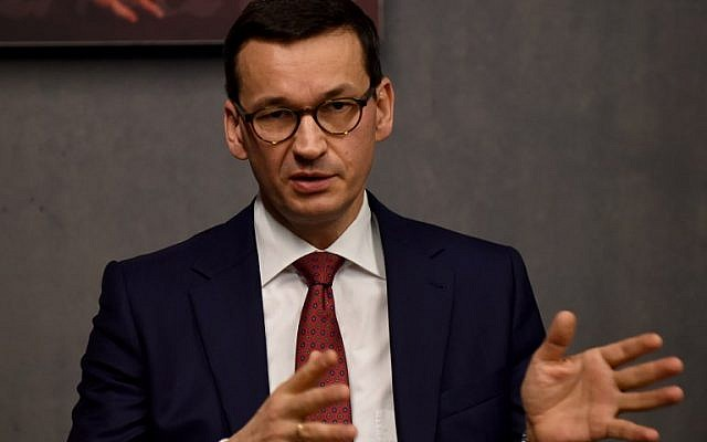 Poland's Prime Minister Mateusz Morawiecki talks to the press during his visit on January 2, 2018, to the Ulma Family Museum, which documents the fate of the Polish Ulma family, killed in March 1944 by Nazi Germans for rescuing Jews during the Holocaust, in the village of Markowa, southeastern Poland. (AFP/Janek Skarzynski)