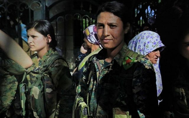 A picture taken on February 2, 2018, in the town of Afrin shows a picture of late 23-year-old YPJ fighter Barin Kobani, displayed on the phone of Amed Kendal, a military commander of the YPJ. (AFP Photo/Delil Souleiman)