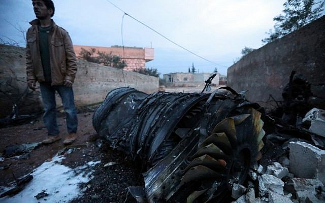 A picture taken on February 3, 2018, shows parts of a downed Sukhoi-25 fighter jet in Syria's northwest province of Idlib. (Omar Haj Kadour/AFP)
