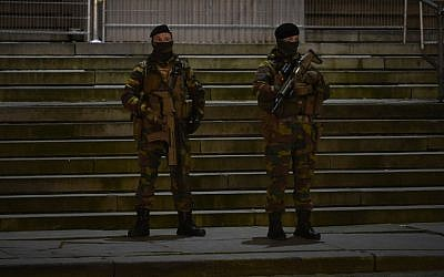 Belgian soldiers stand guard at the entrance of the Palais de Justice courthouse in Brussels on February 5, 2018. (AFP Photo/John Thys)
