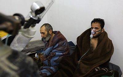 Syrians reportedly suffering from breathing difficulties following Syrian regime air strikes on the northwestern town of Saraqeb at a field hospital in a village on the outskirts of Saraqeb, due to the lack of hospitals in the town, on February 4, 2018. (AFP / OMAR HAJ KADOUR)