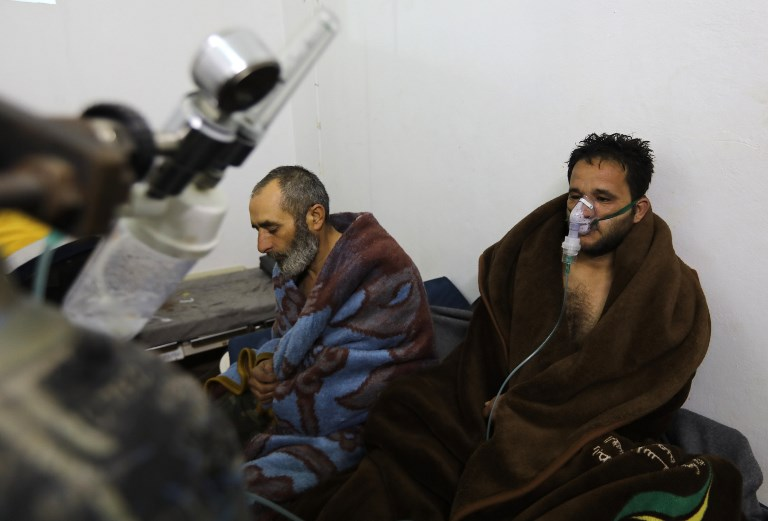Syrians reportedly suffering from breathing difficulties following Syrian regime air strikes on the northwestern town of Saraqeb at a field hospital in a village on the outskirts of Saraqeb due to the lack of hospitals in the town