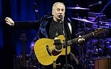 In this file photo taken on November 17, 2016 US singer Paul Simon performs on stage at the Bilbao Exhibition Center in the Spanish Basque city of Barakaldo on November 17, 2016. (AFP/Ander Gillenea)
