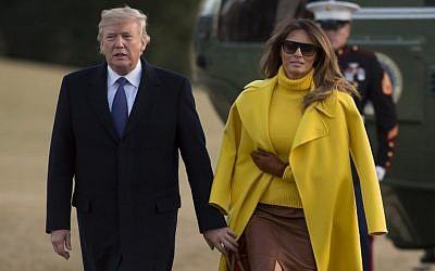 US President Donald Trump and First Lady Melania Trump walk across the South Lawn upon arrival on Marine One at the White House in Washington, DC, February 5, 2018. (AFP/ SAUL LOEB)