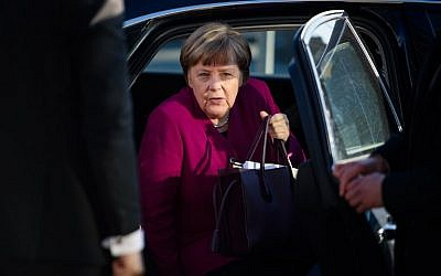 German Chancellor Angela Merkel, leader of the conservative Christian Democratic Union (CDU), gets out of her car as she arrives for further talks to form a new government in Berlin, February 6, 2018. (DPA/Gregor Fischer/AFP)