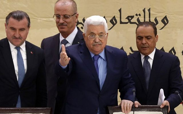 "Palestinian Authority Mahmoud Abbas (C) attends the ""Jerusalem Conference as the Capital of the Islamic Youth"" in the West Bank city of Ramallah on February 6, 2018. (AFP PHOTO / ABBAS MOMANI)"