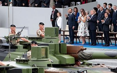 In this file photo taken on July 14, 2017 French officials and US President Donald Trump watch as members of the 4th Foreign Regiment march in the annual Bastille Day military parade in Paris. (AFP PHOTO / Joel SAGET)