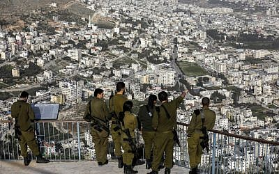 Israeli soldiers on a lookout on Mount Gerizim, above the Palestinian city of Nablus, on February 7, 2018. (AFP / MENAHEM KAHANA)