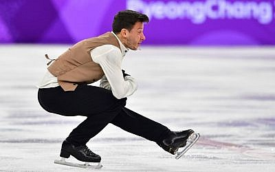 Israel's Alexei Bychenko competes in the figure skating team event men's single skating short program during the Pyeongchang 2018 Winter Olympic Games at the Gangneung Ice Arena in Gangneung on February 9, 2018. (AFP /Mladen ANTONOV)