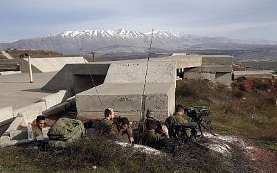 A picture taken on February 10, 2018, shows Israeli solders taking positions in the Golan Heights near the border with Syria. (AFP/ JALAA MAREY)