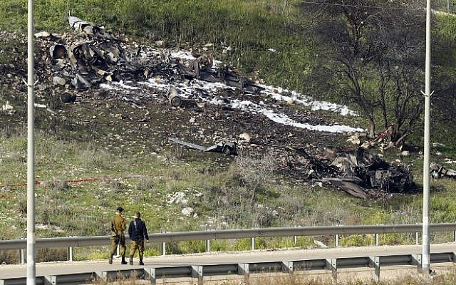 The remains of an F-16 that crashed after coming under fire by Syrian air defenses, in the northern Israeli Kibbutz Harduf, on February 10, 2018. (AFP Photo/Jack Guez)