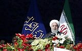 Iranian President Hassan Rouhani delivers a speech at the Azadi Square in the capital Tehran during a ceremony to mark the 39th anniversary of the Islamic revolution, on February 11, 2018. (AFP PHOTO / ATTA KENARE)