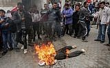 Palestinian demonstrators burn an effigy depicting US President Donald Trump during a protest against US aid cuts, outside the United Nations' offices at the Khan Yunis refugee camp in the southern Gaza Strip on February 11, 2018. (AFP/Said Khatib)
