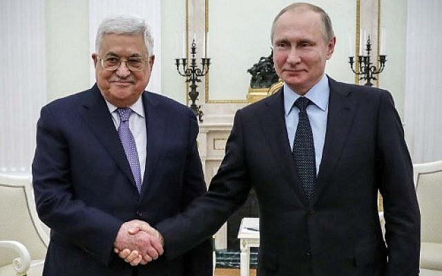 Russian President Vladimir Putin (R) shakes hands with Palestinian Authority President Mahmoud Abbas, during their meeting at the Kremlin in Moscow, on February 12, 2018. (AFP PHOTO/SPUTNIK/Mikhail KLIMENTIEV)
