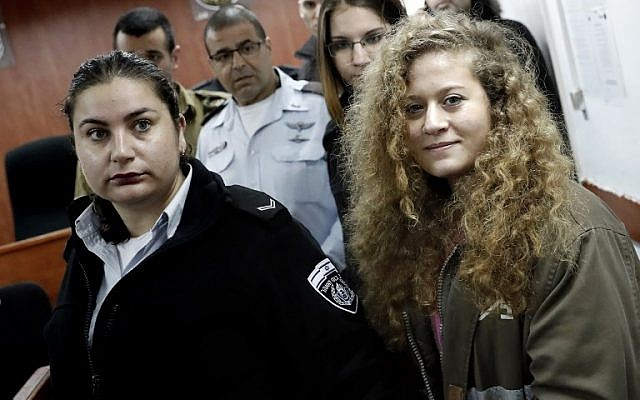 Seventeen-year-old Palestinian Ahed Tamimi, right, arrives for the beginning of her trial in the Israeli military court at Ofer military prison in the West Bank village of Betunia, February 13, 2018. (Thomas Coex/AFP)