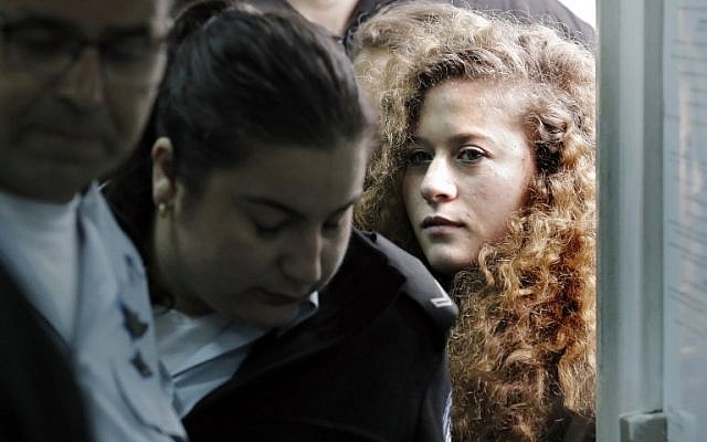17-year-old Palestinian Ahed Tamimi (R), arrives for the beginning of her trial at the Ofer Military Court in the West Ban on February 13, 2018. (Thomas Coex/AFP)