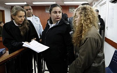 17-year-old Palestinian Ahed Tamimi (R) arrives for the beginning of her trial at the Ofer Military Court in the West Bank on February 13, 2018. (Thomas Coex/AFP)