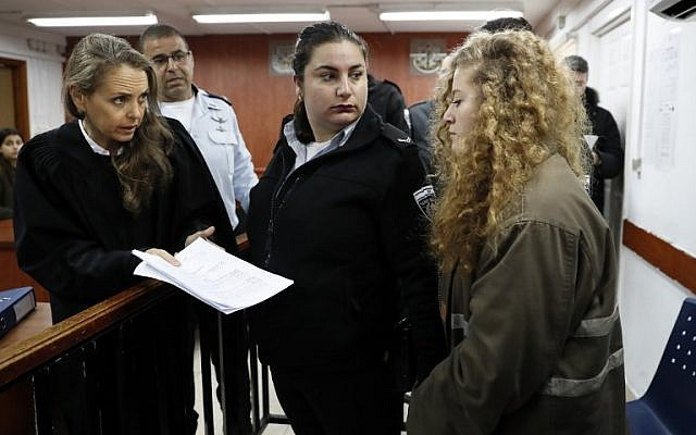 Illustrative: 17-year-old Palestinian Ahed Tamimi (R) arrives for the beginning of her trial at the Ofer Military Court in the West Bank on February 13, 2018. (Thomas Coex/AFP)