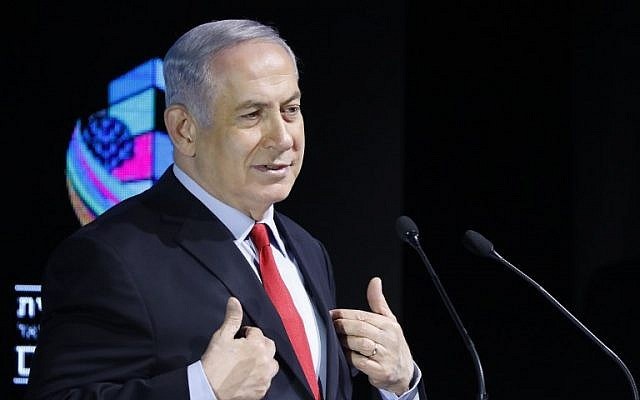 Prime Minister Benjamin Netanyahu gestures as he attends the Muni Expo 2018 conference in Tel Aviv on February 14, 2018. (Jack GUEZ/AFP)