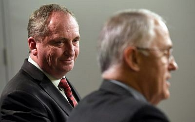 This file photo taken on July 5, 2016 shows Australia's Deputy Prime Minister Barnaby Joyce (L) looking at Prime Minister Malcolm Turnbull (R) during a press conference in Sydney. (AFP PHOTO / William WEST)