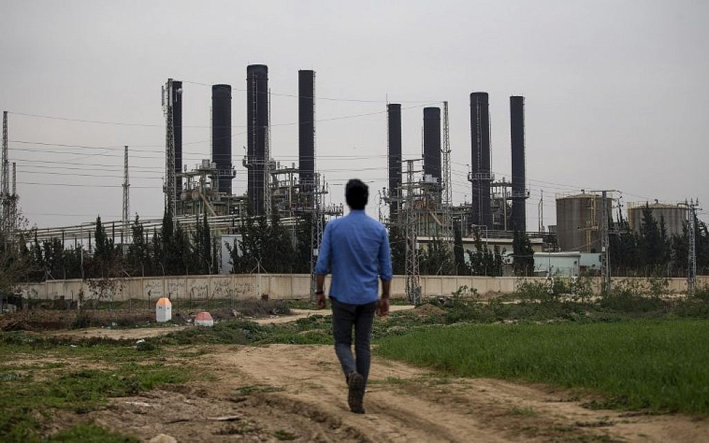 A Palestinian youth walks towards the Gaza strip's sole electricity plant, which provides a fifth of the embattled region's power needs, after it stopped working at midnight the previous night due to lack of fuel as per local officials, on February 15, 2018. (MOHAMMED ABED/AFP)