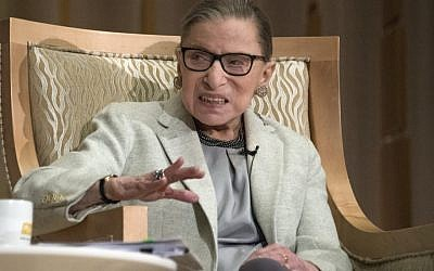 Ruth Bader Ginsburg talks to congregants of the Adas Israel synagogue in Washington, DC, February 1, 2018. (Ron Sachs/CNP via JTA)