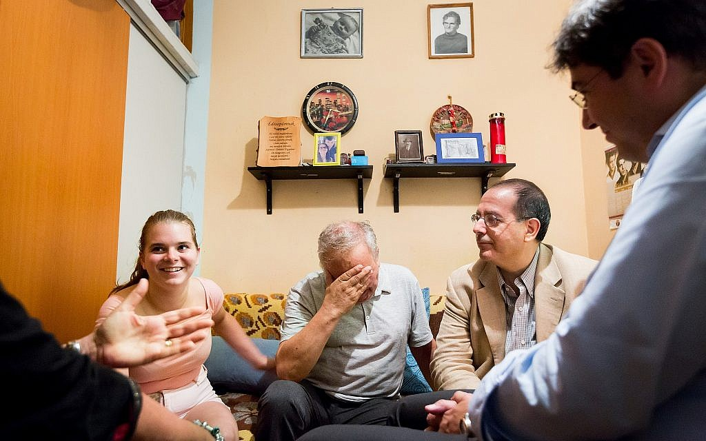CEO of the American Jewish Joint Distribution Committee (JDC) David M. Schizer at a home visit with a family of impoverished Jews in Budapest. (courtesy)